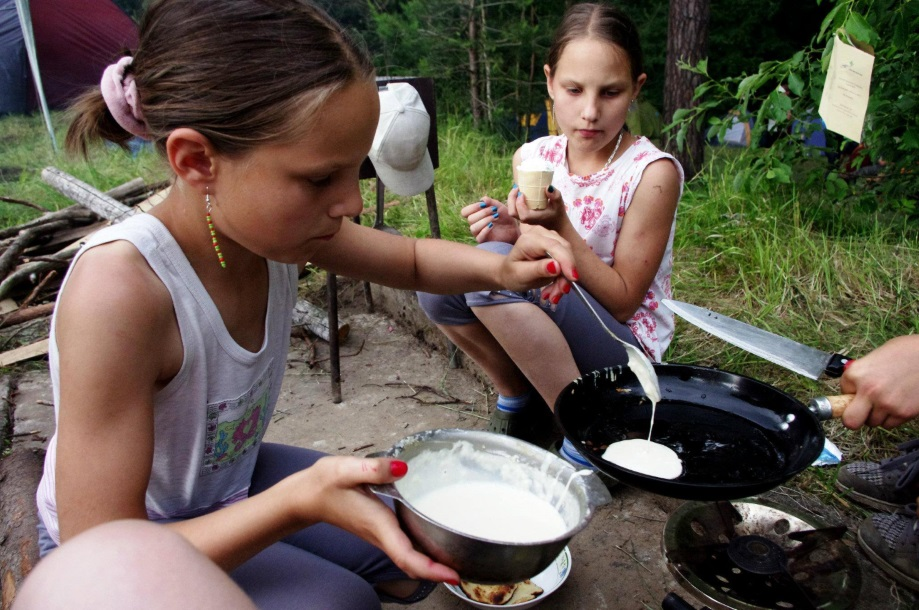 Making pancakes while camping