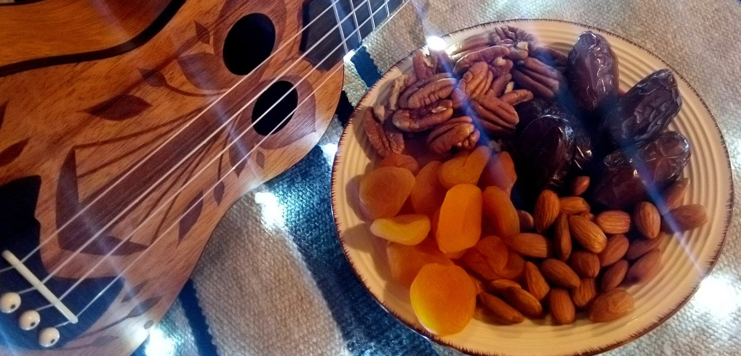 Ukulele with fruit and nuts