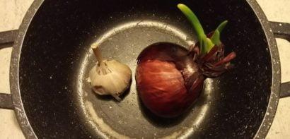 Onion and garlic in saucepan