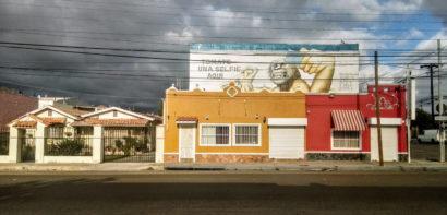 Empty Tijuana street with dramatic sky